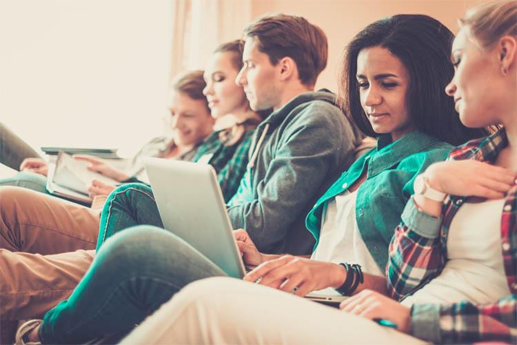 group of university students on laptop